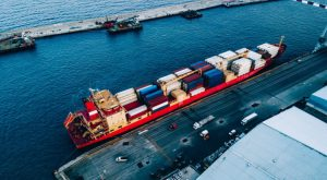Aerial top view of industrial cargo container logistics ship in terminal in Italy